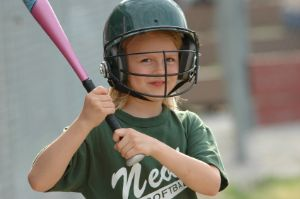 Young girl wearing at bat
